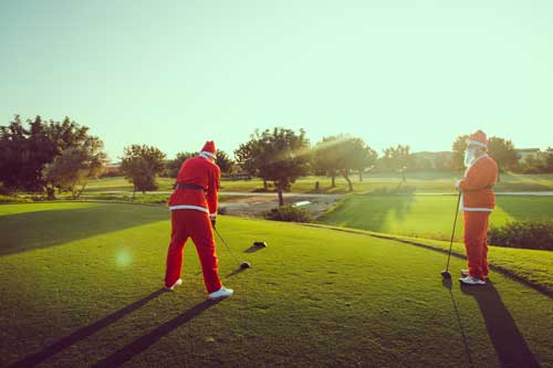 2 santas playing golf